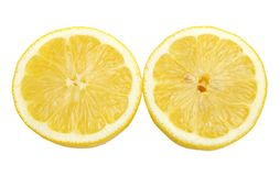 Lemon halves cutout. Bright yellow lemon halves cutout on white background Royalty Free Stock Photography