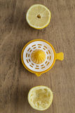 Lemon halves and lemon squeezer Stock Photo