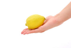 Lemon in hand Stock Photo