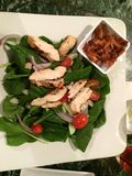 Lemon herb chicken salad. Bistro delicious yummy grilled tomatoes spinach balsamic date night dinner Friday restaurant pretty good meal ensalada stock image