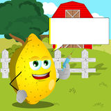 Lemon holding syringe on a farm with speech bubble Royalty Free Stock Photography