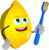 Lemon holding tooth brush Stock Photography