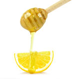 Lemon with honey Stock Photo
