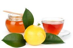 Lemon, honey and tea Stock Images