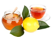 Lemon, honey and tea Stock Photography
