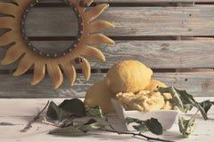 Lemon ice cream. Cream of lemon ice cream decorated with lemon leaves and some lemons of ornament stock photos
