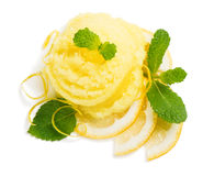 Lemon ice cream and zest, above view. Top view of scoop of lemon ice cream decorated with zest and mint isolated on white background royalty free stock photo
