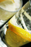 Lemon and Ice Cubes in Soda Water Royalty Free Stock Image