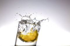 Lemon with ice. Isolated lemon in a cup of water and ice cubes Stock Photo