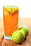 Lemon ice tea. Chilled lemon ice tea with fresh lemon over wooden surface Stock Image