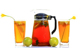 Lemon ice tea. Chilled lemon ice tea pitcher and glasses with white background Royalty Free Stock Image