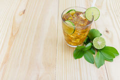 Lemon ice tea. On brown wooden table with lemons Stock Images