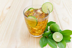 Lemon ice tea. On brown wooden table with lemons Royalty Free Stock Images