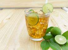 Lemon ice tea. On brown wooden table with lemons Royalty Free Stock Photos