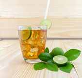 Lemon ice tea. On brown wooden table with lemons Stock Photos