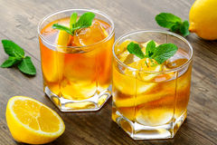 Lemon ice tea on brown wooden table with lemons Royalty Free Stock Photo