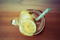 Lemon ice tea in glass with slice of lemon and lime stock photography