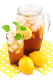 Lemon ice tea. In the jug on white background Stock Images