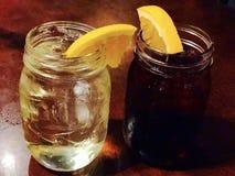 Lemon ice tea in mason jar with wedge of lemon. On table vector illustration