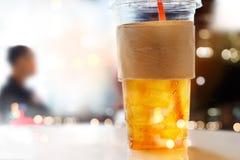 Lemon ice tea in plastic glasses on restaurant background, soft focus Royalty Free Stock Photos