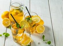 Lemon ice tea served on wooden table Stock Photos
