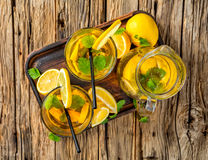 Lemon ice tea served on wooden table Royalty Free Stock Photos