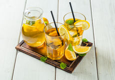 Lemon ice tea served on wooden table Royalty Free Stock Images