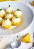 Lemon icecream served in half of lemon Royalty Free Stock Photos