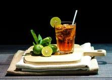 Lemon Iced Tea on Wood Table. And Black Background Stock Photos