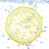 Lemon In A Liquid With Bubbles. Royalty Free Stock Photography