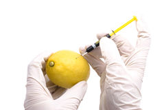 Lemon injected with chemicals Stock Photo