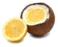 Lemon inside, beside coconut on white Royalty Free Stock Photos