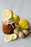 Lemon jam with ginger. A Can of lemon jam with ginger wooden background, selective focus Royalty Free Stock Photos