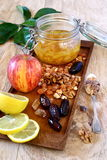 Lemon jam, nuts and dried fruits Royalty Free Stock Image