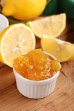 Lemon jam on wooden table Stock Image