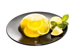 Lemon jelly on dark plate Stock Photos