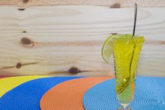 Lemon Jelly. A glass with lemon jelly on a colorful background Stock Image