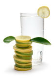 Lemon juice. And stacked slices on white Royalty Free Stock Photos
