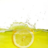 Lemon into juice Royalty Free Stock Images