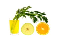 Lemon juice with a bunch of dill and half orange apple Royalty Free Stock Image