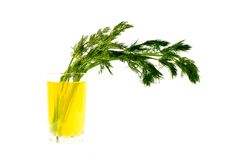 Lemon juice with a bunch of dill Stock Photos