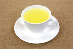 Lemon juice in cup and saucer royalty free stock image
