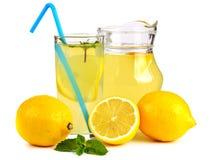 Lemon juice and fruit Stock Photos