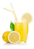 Lemon juice glass and fresh lemons Royalty Free Stock Image