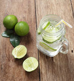 Lemon juice glass and fresh lemons Royalty Free Stock Images