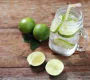 Lemon juice glass and fresh lemons Royalty Free Stock Photos