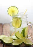 Lemon juice glass and fresh lemons Stock Images