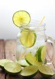 Lemon juice glass and fresh lemons Stock Images