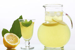 Lemon juice in glass jug Stock Images