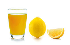 Lemon juice in a glass and lemon Stock Images